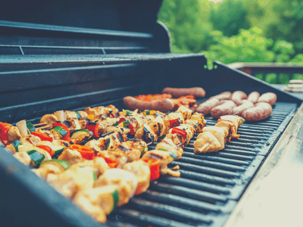 kebabs and sausage on grill