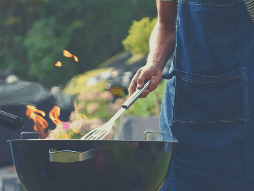 man grilling with flame