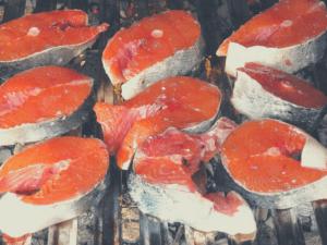 salmon smoking on a grill