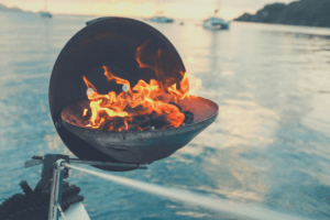 Boat grill charcoals on fire
