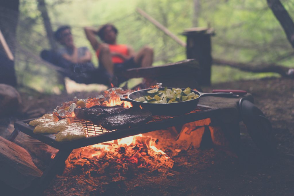 food grilling over campfire