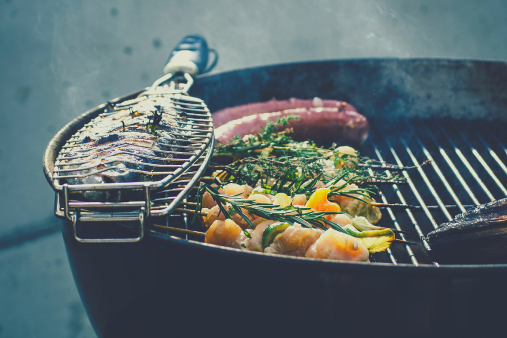 fish veggies and sausage on tabletop grill